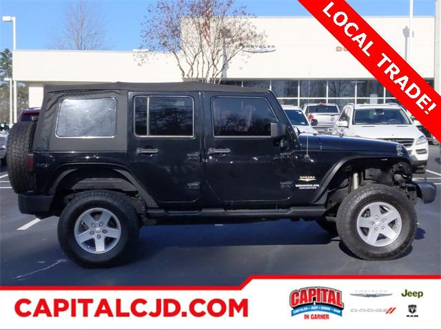 2013 Jeep Wrangler Unlimited SAHARA SUV Slide